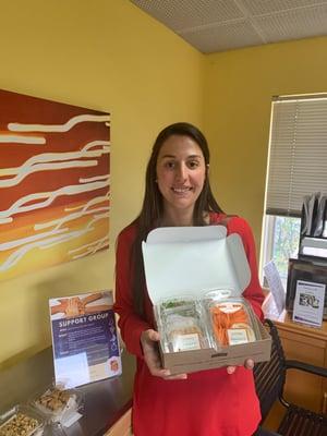RDN Kathleen Tabb holding box of food.