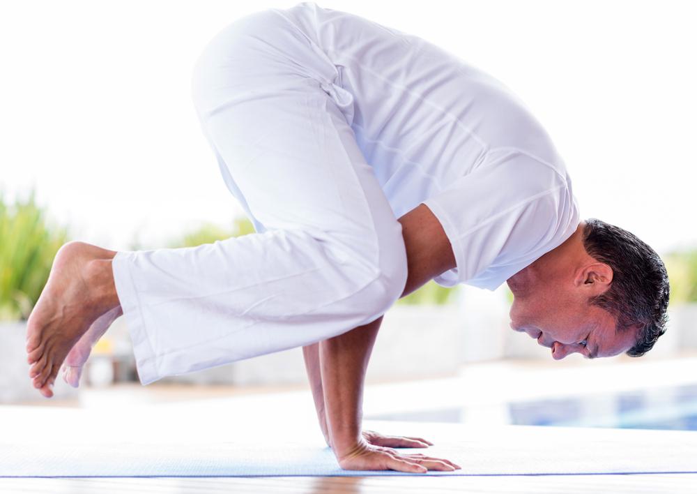 Man meditating in a hard yoga position